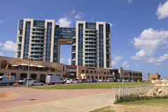 Modern apartment buildings and Arena shopping mall on promenade Royalty Free Stock Images