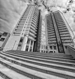 Modern apartment buildings exteriors background / condo with office buildings stock image