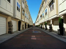 Modern apartment buildings facing each other. Modern and new apartment building or townhouses built extremely dense, close to each other in long straight rows Royalty Free Stock Photo