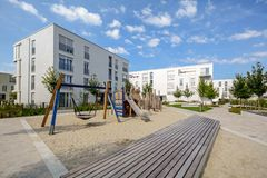 Modern apartment buildings in a green residential area in the city. Europe Royalty Free Stock Images