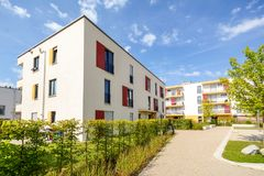 Modern apartment buildings in a green residential area in the city. Europe Royalty Free Stock Photo