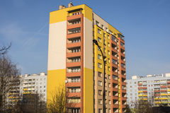 Modern Apartment Buildings in Krakow, Poland. KRAKOW, POLAND - DECEMBER 5, 2016:  Modern colorful urban apartment block buildings in Krakow against blue sky Royalty Free Stock Photography
