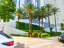 Modern apartment buildings with palm trees at Collins Avenue Stock Photo