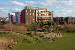 Modern apartment buildings with a parc and playground, part of the urban expansion of the city of Ghent, Flanders. Modern apartment buildings with a parc and Royalty Free Stock Photos
