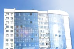 Modern apartment buildings on a sunny day with a blue sky. Facade of a modern apartment building stock image