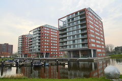 Modern apartment buildings on water Stock Images