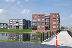 Modern apartment buildings waterfront Stock Images