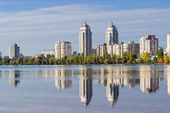 Modern apartment complex on the banks of the river Stock Images