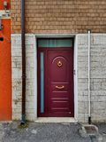 Modern apartment front door in a multicolored ambience. Royalty Free Stock Photography