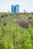 Modern apartment house and green forest in spring Stock Photography