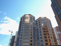 Modern apartment house. Modern multi-storey residential building, modern residens, skyscraper, residential quarter for people Royalty Free Stock Image