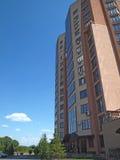 Modern apartment house. Modern multi-storey residential building, modern residens, skyscraper, residential quarter for people, green yard Stock Images