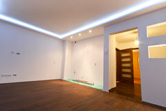 Modern apartment interior. With LED ceiling lights Stock Images