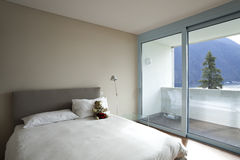 Modern apartment interior view. Bedroom Stock Images