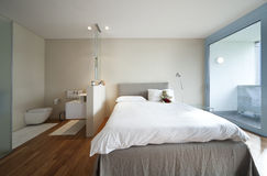 Modern apartment interior view. Bedroom and bathroom Stock Images