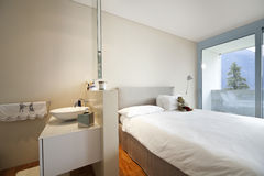 Modern apartment interior view. Bedroom and bathroom Stock Image