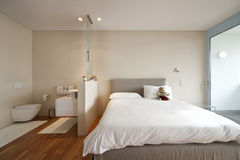 Modern apartment interior view. Bedroom and bathroom Royalty Free Stock Images