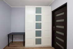 Modern apartment interior with wardrobe Royalty Free Stock Photos