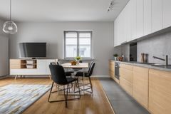 Modern wood kitchen with table royalty free stock photography