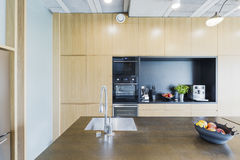 Modern apartment's kitchen with avantgarde decor Royalty Free Stock Photography