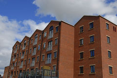 Modern Apartments. Modern apartment block with balconies and open doors Stock Photos
