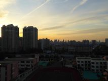Modern apartments buildings outline. Beautiful sunset light with modern apartment buildings in Shanghai China Royalty Free Stock Image