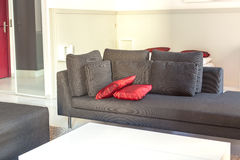 Modern apartments cozy furniture: a sofa with pillows Royalty Free Stock Photos