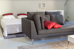 Modern apartments cozy furniture: a sofa with pillows Stock Image