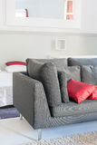 Modern apartments cozy furniture: a sofa with pillows Stock Images