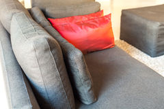 Modern apartments cozy furniture: a sofa with pillows Stock Photo