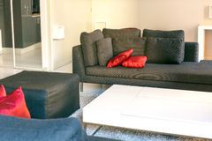 Modern apartments cozy furniture: a sofa with pillows Royalty Free Stock Images