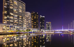 Modern apartments in Docklands, Melbourne at night. Modern apartments and a spectacular marina in Docklands in Melbourne, Australia at night stock photography