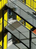 Modern apartments in Montreal, Canada. Yellow wall & grey balconies in centre-sud area. Lens: Sigma 70-200 APO EX HSM Stock Photos