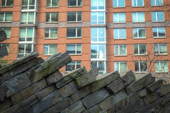 Modern apartments with rock wall landscaping Stock Images