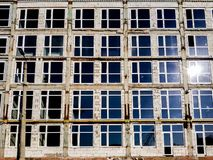 Modern apartments style windows and concrete walls before finishing and painting. royalty free stock photos