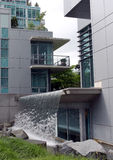 Modern apartments with waterfall. Modern luxury apartment buildings in downtown Vancouver with waterfall blending urban living with a park like setting Stock Images
