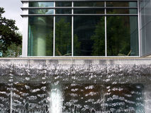 Modern apartments with waterfall. Modern luxury apartment buildings in downtown Vancouver with waterfall blending urban living with a park like setting Royalty Free Stock Photography