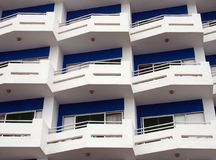 modern apartments with white balconies and blue details with angular railings royalty free stock photo