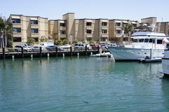 Modern Apartments and a Yacht. A Modern Apartments and a Yacht at the New Port Beach with architectural design of windows and balconies down on the grounds are a Stock Photos