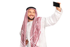 Modern Arab taking a selfie with cell phone Stock Photos