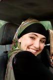 Modern Arabian girl. In the car royalty free stock photo