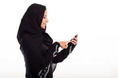 Arabian girl phone. Modern arabian girl using smart phone isolated on white Royalty Free Stock Images