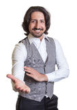 Modern arabian man inviting his guests. On an isolated white background for cut out Royalty Free Stock Photo
