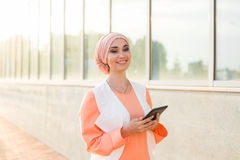 Modern Arabian muslim woman with tablet computer outdoors.  Stock Image