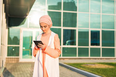 Modern Arabian muslim woman with tablet computer outdoors.  Royalty Free Stock Photo