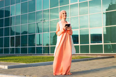 Modern Arabian woman with tablet computer. Muslim woman Royalty Free Stock Photos