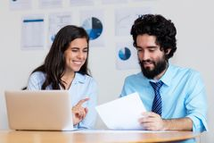 Modern arabic business team at work at desk stock photos