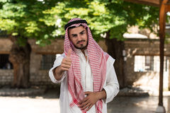 Modern Arabic Businessman Holding Thumbs Up Stock Photos