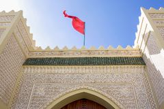 Modern arabic palace with arabesques on the facade. And tower in the desert Royalty Free Stock Photo