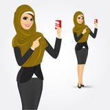 Modern arabic woman holding a credit card Royalty Free Stock Photos